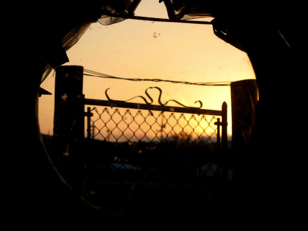 View of a gate through the wagon window.