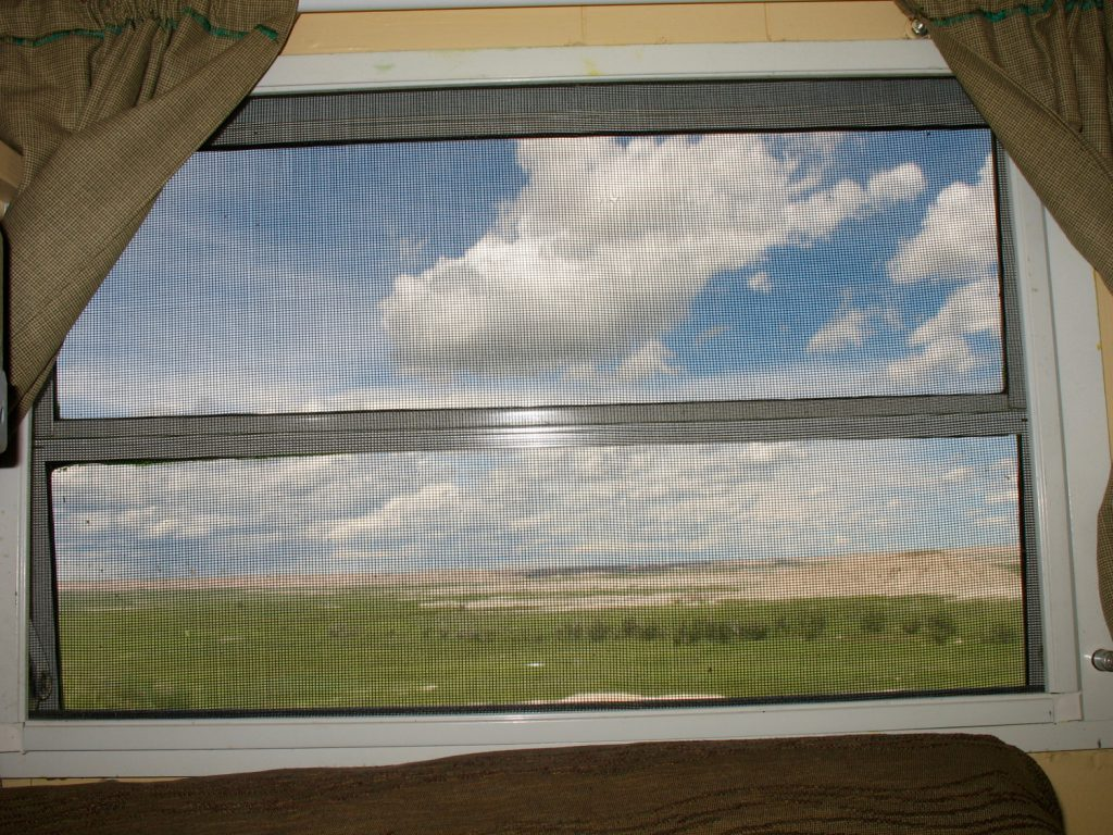 This is what the South Dakota Badlands looks like from the inside the wagon. Sometimes, the scenery was so big, I just couldn't take it and crawled back in to my wagon. (outside Interior, SD)