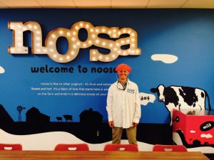 Bernie in front of the noosa breakroom sign.